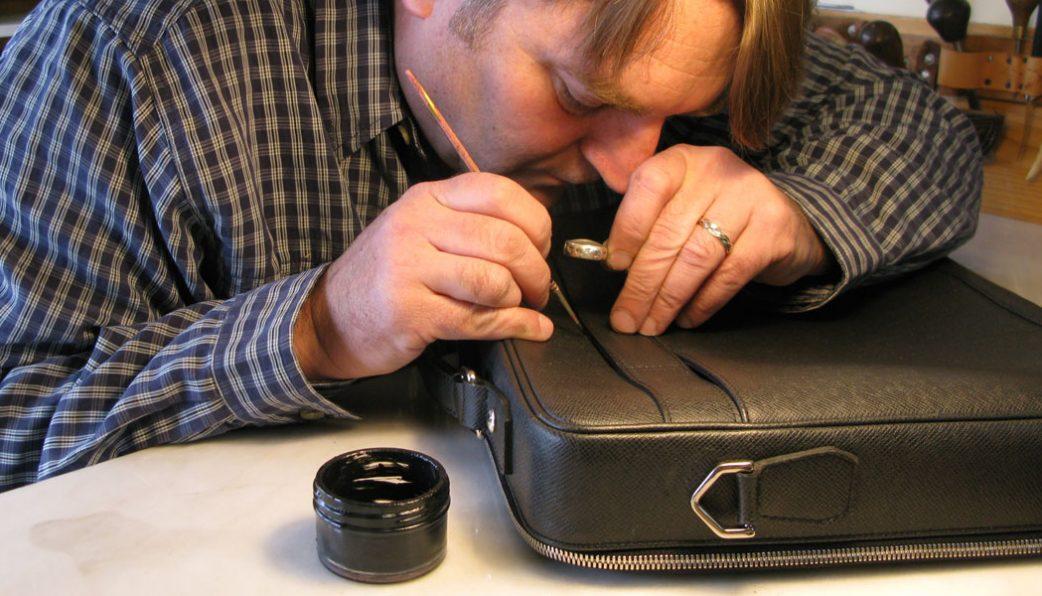 especialista em conserto de malas